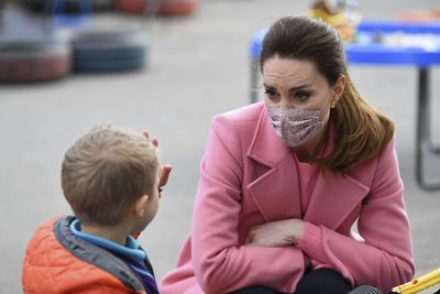 Kate shares a moment with a little boy, March