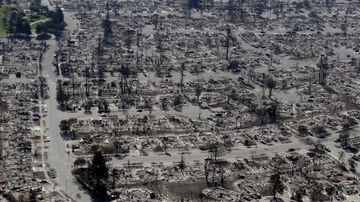 An aerial view shows the devastation of the Coffey Park neighborhood after a wildfire swept through Saturday, Oct. 14, 2017, in Santa Rosa, Calif. (AP Photo/Marcio Jose Sanchez)