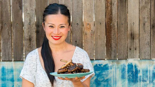 Poh Ling Yeow holding a plate of lamb for We Love Our Lamb. Image: Supplied