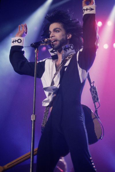 "Performing in 1990 wearing a suit emblazoned with the foundations for his distinctive ""Love Symbol""."