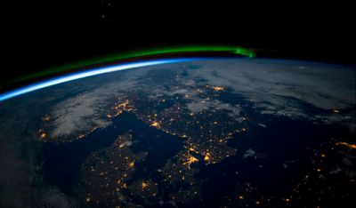 "<p>Astronauts aboard the International Space Station have taken stunning images of Earth, and NASA Johnson Space Center's Earth Observation team have compiled their top 15 photographs of 2015. </p><p>Here, astronauts captured a green aurora over Scandinavia before midnight, under a full moon, on April 3. </p><p><strong>Click through the gallery to see more stunning images of our world, as seen from space. </strong></p>(All images / <a href=""http://www.nasa.gov/feature/top-15-earth-images-of-2015"">NASA</a>)"