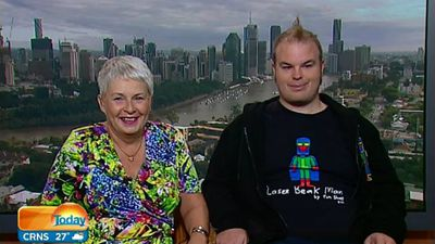 Tim Sharp (right) is a world-renowned artist whose work has graced the galleries of New York City, been transformed into a cartoon, and is collected by movie stars. His mother, Judy (left) never imagined this level of success when Tim was diagnosed with autism aged three, and she has written a book about their journey. (9NEWS)