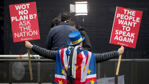 Anti Brexit protestor Steve Bray attempts to appear in shot behind a television crew on Abingdon Green, outside the Houses of Parliament, in Westminster, London.