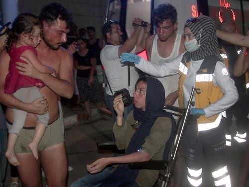 Turkish paramedics help people rescued from a boat that capsized off Cyprus' northern coastline. Picture: AP