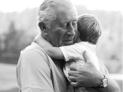 Prince Charles hugging Prince Louis