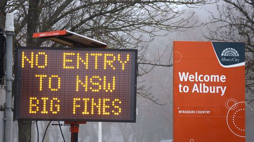 A sign at the NSW border in July.