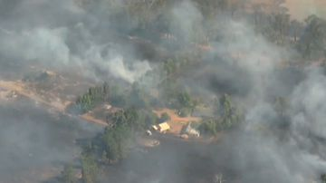 Aerial images show smoke billowing from the bushfire.