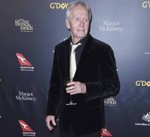 Paul Hogan on the red carpet - with white wine in hand.