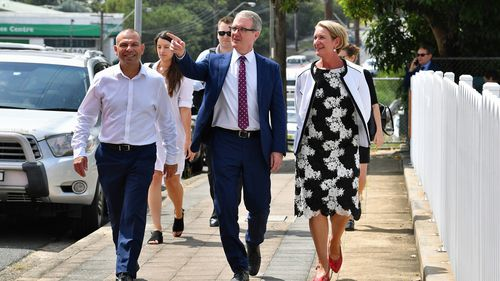 New South Wales Opposition Leader Michael Daley (centre) with Labor candidate for Heathcote Maryanne Stuart (right) and Legislative Council Candidate Mark Buttigieg (left) at Engadine train station in Sydney.