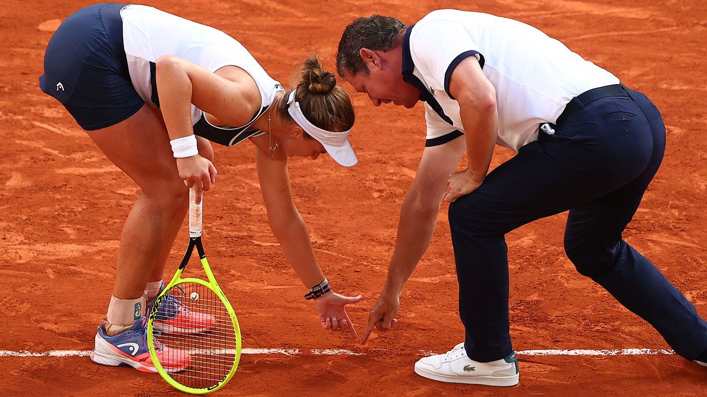 Barbora Krejcikova points to the court as she contests a line call with the umpire in her Semi-Final Women's Singles match against Maria Sakkari at Roland-Garros.