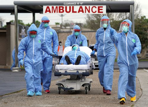 A person is taken on a stretcher into the United Memorial Medical Centre after going through testing for COVID-19 Thursday, March 19, 2020, in Houston. Picture: David J. Phillip