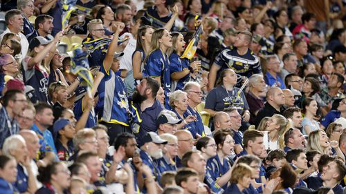 Spectators look on during the Round One NRL match at North Queensland Stadium.