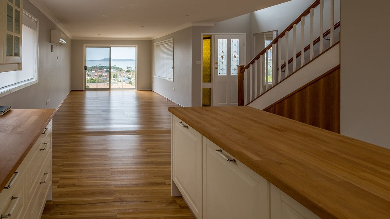 BEFORE: The open plan living and dining area from the kitchen with its own water view
