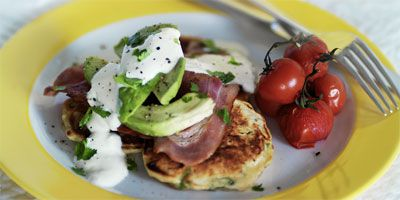 Corn fritters with bacon, avocado & tomatoes