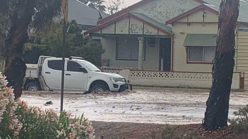 The flash flooding reached half-way up this 4WD ute's wheels.