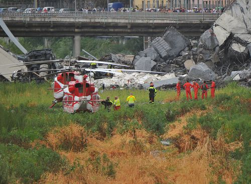 Rescue workers operate out of the marshy Polcavera River the A10 bridge crossed. Picture: AP