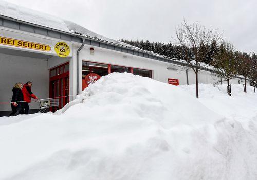 Snow next to a supermarket near Breitenbrunn at Ore mountains, Germany.