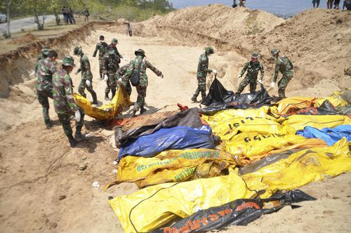 Authorities had to bury more than 150 bodies in a mass grave in the city of Palu.
