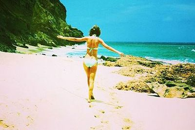 "Taylor Swift posted this smokin' bikini picture to her Instagram, captioned: ""Looking for Easter eggs..."""