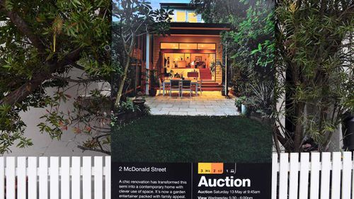 A for sale sign is displayed in front of a house in Sydney earlier this year. (Image: AAP)
