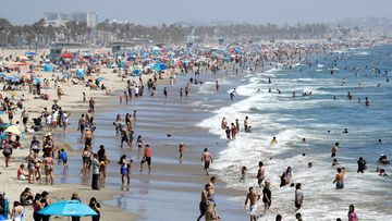 Visitors crowd the beach in Santa Monica, California in July, during the coronavirus pandemic.