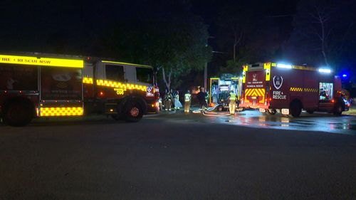 A woman has suffered serious burns to her face and body after going back into a burning house in Marayong, in Sydney's west, to find her dog.