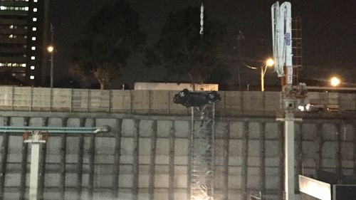 Three young women in hospital after car plunges at least 20m into excavation pit in Melbourne