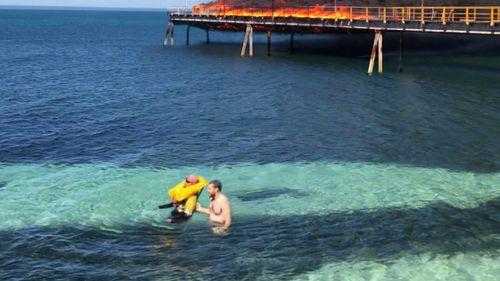 A hero cop rescued a stranded tradesman.