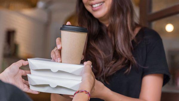 Woman buying coffee