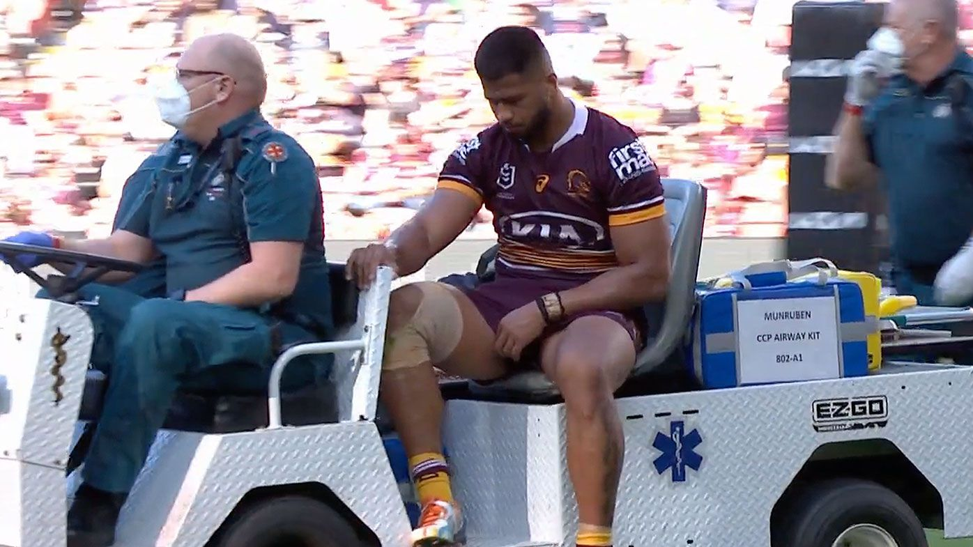 Payne Haas departs on Medicab after suffering serious ankle injury
