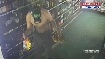 A man fell through the roof of a bottle shop and helped himself to booze.