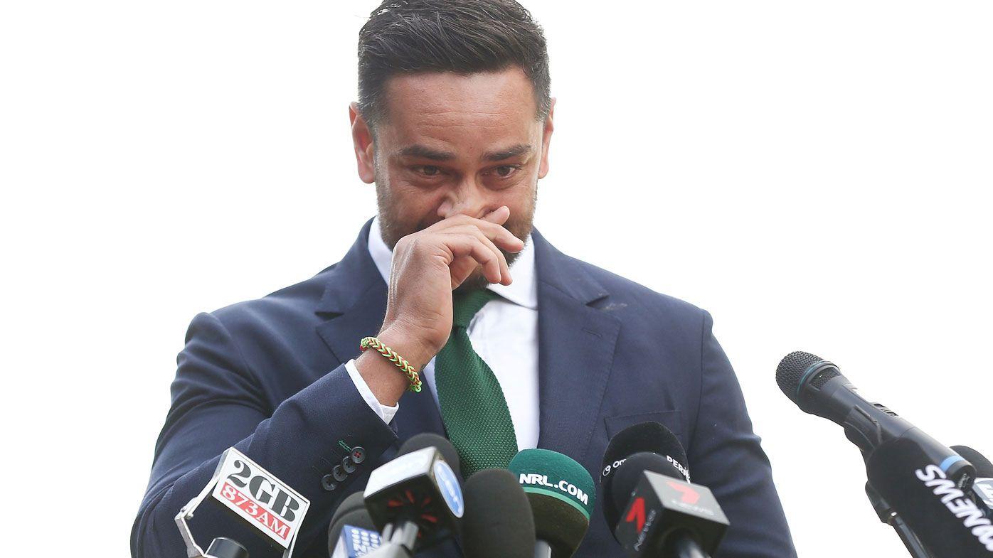 An emotional John Sutton wipes away tears.