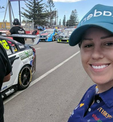 Emily Duggan race car driver trackside