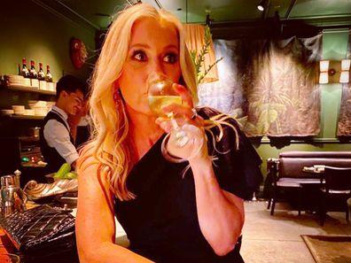 Sami Lukis has a drink in a bar.