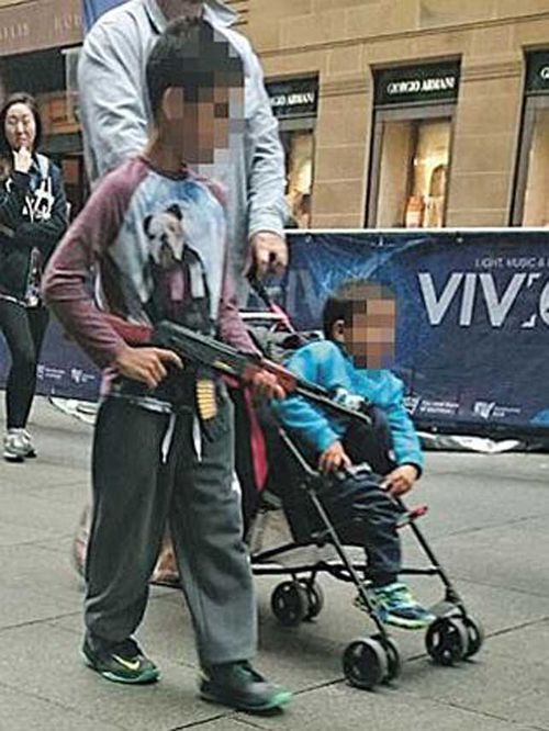 This photo of a boy carrying a toy gun in Martin Place has sparked debate.