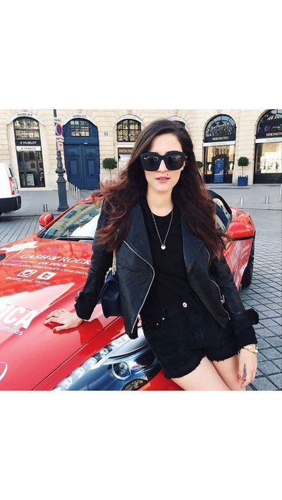 <p>Eleonora Carisi poses with her vehicle of choice.</p>
