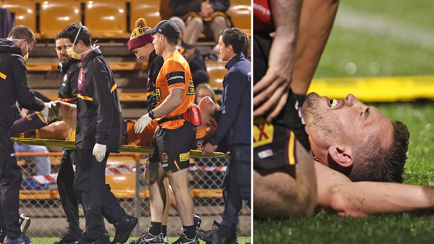 Corey Oates of the Broncos is stretchered off