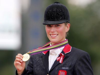 Zara wins a gold medal at the World Equestarian Games, 2006