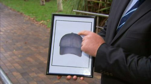 The attacker was wearing a hat similar to this artist's depiction. (9NEWS)