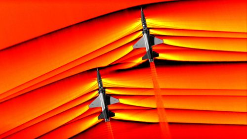 The images show the shockwaves of two aircraft interacting