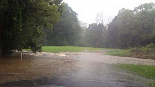 The rain has flooded a private road at Bilambil. (Facebook)