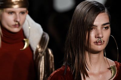<p>Nicholas K's wild tribal accessories were cool, but it was the dramatic gold shimmery eyes that really stole our hearts.</p>