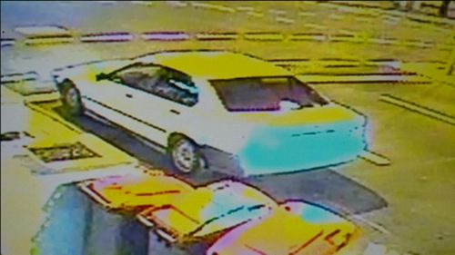 The woman said a man tried to drag her into a silver or white car. (9NEWS)