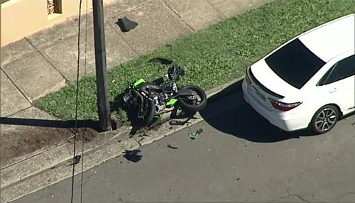A 30-year-old man died after crashing his motorcycle in a suburban street in Auburn and being thrown several metres. Picture: 9NEWS.
