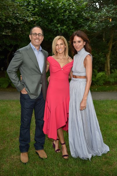 Jerry Seinfeld, Jessica Seinfeld in Peter Pilotto and Net-a-porter's Alison Loehnis in Emilia Wickstead at the Net-a-porter x GOOD+ dinner at the Seinfeld's estate.