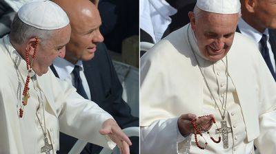 Even people throwing things at him can't upset Pope Francis. (Getty)