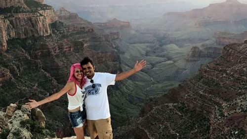 The 'travel obsessed' couple pose at the Grand Canyon. (Facebook)