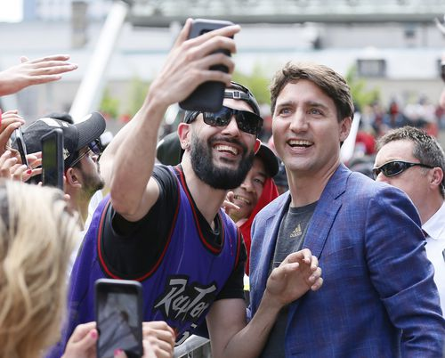 Canadian prime minister Justin Trudeau poses for a selfie with a Toronto Raptors fan. Credit: John E. Sokolowski-USA TODAY Sports.