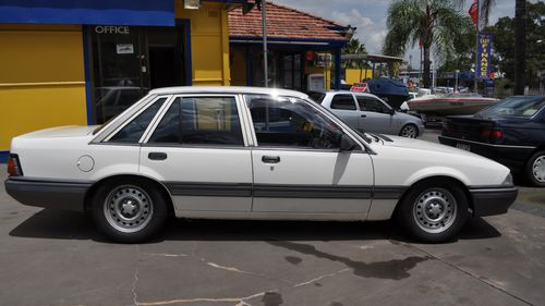 Supplied undated image obtained Monday, May 7, 2012 of a white Holden Commodore sedan, similar to that in which missing girl Jessica Small, then aged 15, was assaulted in by a man while hitch-hiking in Bathurst on Sunday, October 26, 1997.