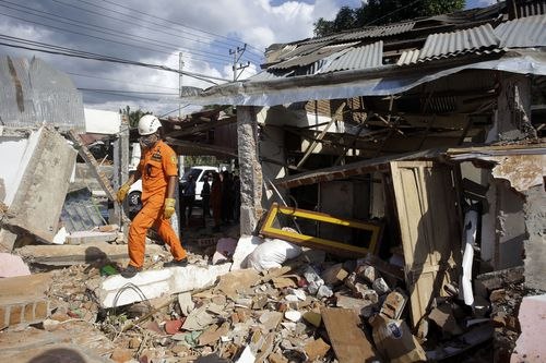 Entire homes were left crumbled or flattened by the tremor. Picture: AAP.